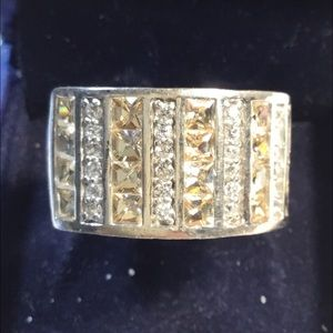 Silver ladies ring with white and yellow stones